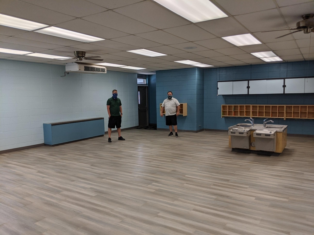 Mr. Strong and Mr. Froehner checking out the new floor!